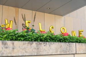 Welcome spelled out in gold baloons
