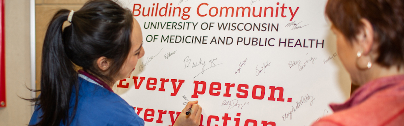 signing Building Community poster